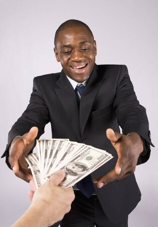giving money: Someone giving many banknotes to an african business man Stock Photo