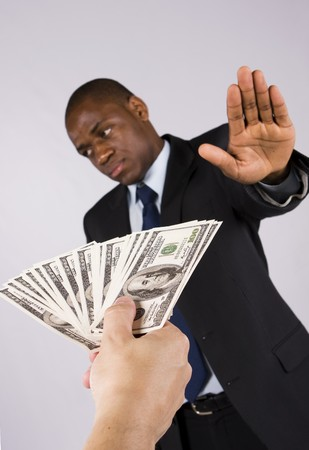 African business man refusing many dollar banknotes
