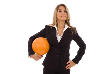 Beautiful woman holding an orange soccer ball photo