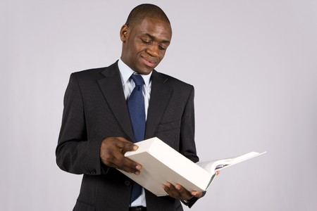 Young lawyer or business man reading a big book photo
