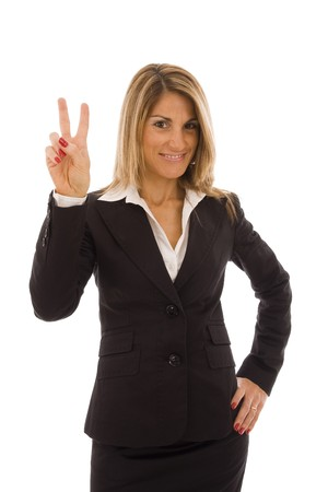 Beautiful business woman doing a victory sign photo
