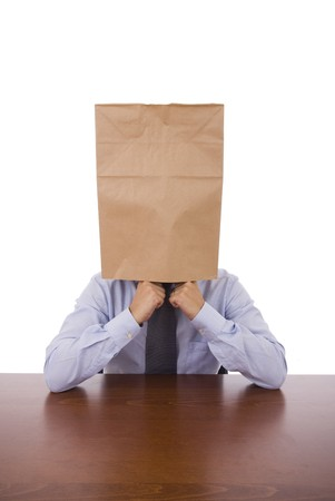 A business man with a cardboard bah on his head photo