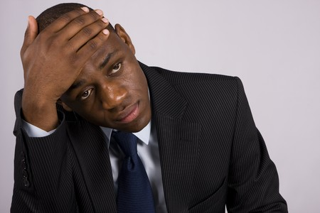 Depressed Business man having an headach Stock Photo