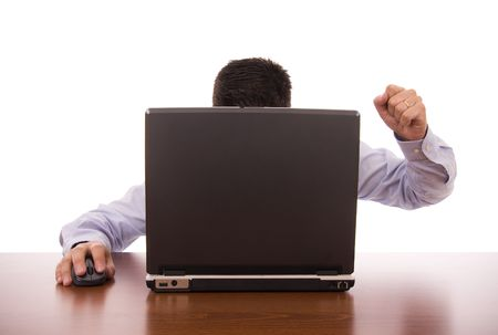 Business man sit in front his computer with a furious expression photo