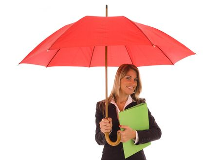 Insurance Concept - Woman protected under a red umbrella photo