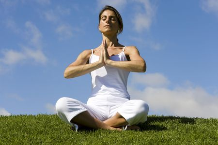yoga outside: Pretty woman in white doing yoga outdoor