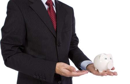 Banking concept - A businessman showing a piggy bank photo