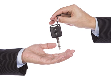 Business man giving a new key car to another man photo