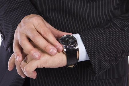 minutes: Businessman checking the time on his watch Stock Photo
