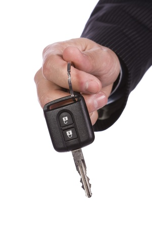Business man giving a new key car photo