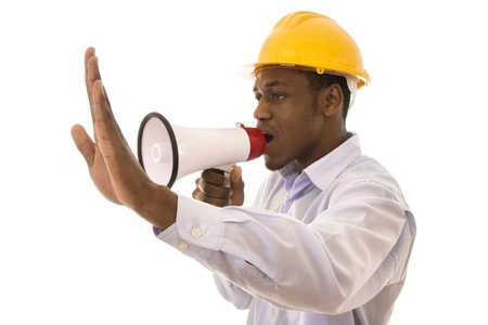 Young black worker giving orders with a megaphone Stock Photo - 9088004