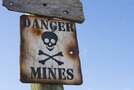 explosive sign: Old sign giving advice about a mined area