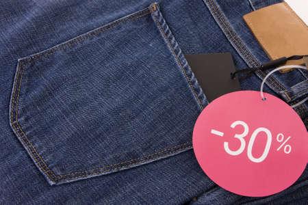 Promotional advise on blue jeans pants  photo