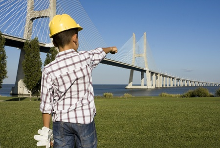 inspector kid: Little engineer pointing to a bridge
