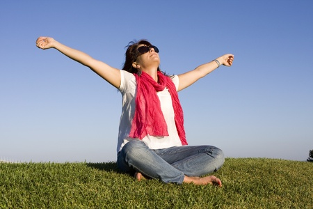 Beautiful woman enjoying life with her arms outstretched photo