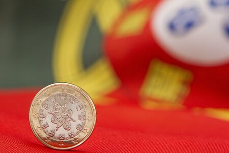 Portuguese Euro Coin with the national flag on background Stock Photo - 11409332