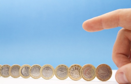 credit union: Concept about the european monetary crisis - Hand ready to cause a chain reaction Stock Photo