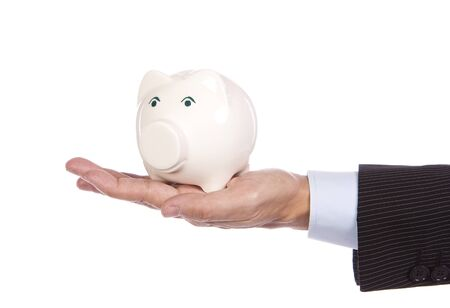 Saving concept - Male�s hand holding a white piggy bank photo