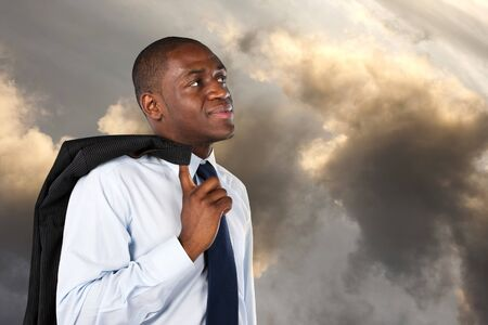 Business man looking at the sky at the end of the day Stock Photo - 15219103