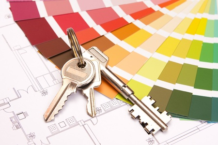 Color samples for selection with house keys and a blueprint photo