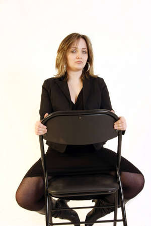 young business woman sitting on a chair Stock Photo