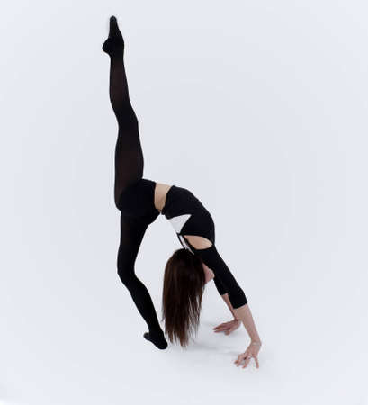 Young gymnast in studio photo