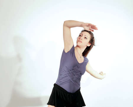 Young pretty teenage girl brunette Dancing in studio with long hair Stock Photo