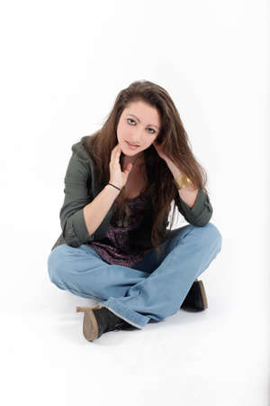 Young pretty teenage girl brunette in studio with long hair Stock Photo