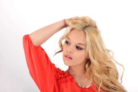 Young pretty teenage girl in studio with long hair
