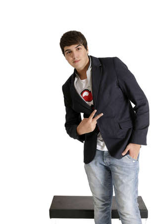 Young teenager male in studio, brown hair, white background