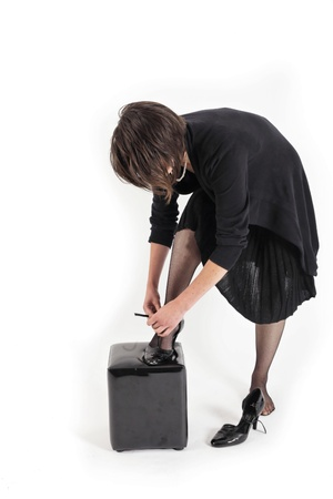 young brunette woman looking like a nanny or widow wearing a black shoe Stock Photo
