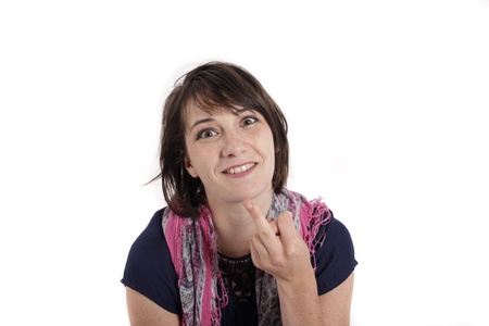 humorous portrait of a young brunette woman with finger of her mouth, colored scarf