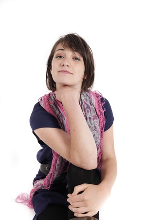 portrait of a young brunette woman with colored scarf looking ahead Stock Photo