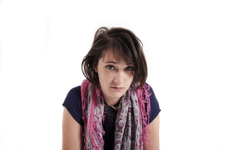 variation of expression on the face of a young brunette woman in studio with a colored scarf Stock Photo