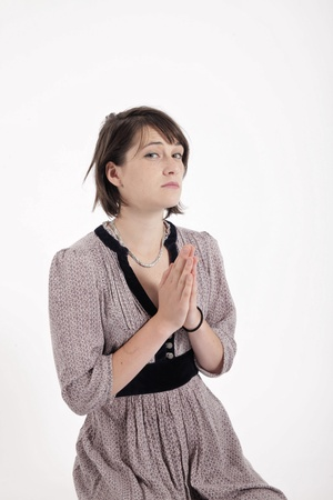 portrait of a young brunette woman requesting in catholic posture united hand Stock Photo