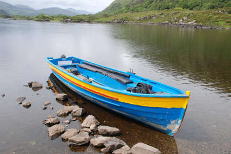 co  kerry: Moored boat on one of the Lakes of Killarney, Co. Kerry, Republic of Ireland, a summers afternoon
