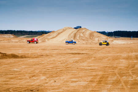 land slide: Rally car speeding through the dusty conditions at high speed Stock Photo