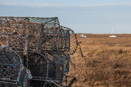 lobster pot: A stack of lobster pots by the sea, ready to used again