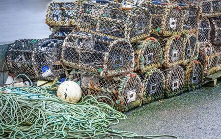 lobster boat: A stack of lobster pots by the sea, ready to used again