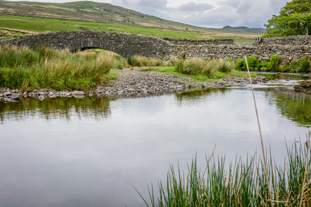 lake district england: Rural stone bridge across a small river on a moor in the Lake District in north England