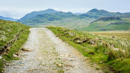 lake district england: Rural stone road across a moor in the Lake District in north England