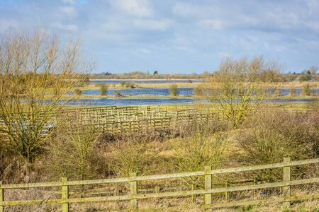 frence: Flooded farmland in Norfolk UK on a bright day in Winter Stock Photo