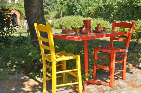 skiathos: Colourful table and chairs in a restaurant in greece on a lovely summers day