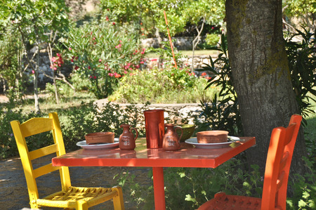 taverna: Colourful table and chairs in a restaurant in greece on a lovely summers day