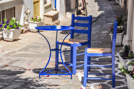skiathos: A street restaurant in Skopelos town, with traditional blue table and chairs Stock Photo