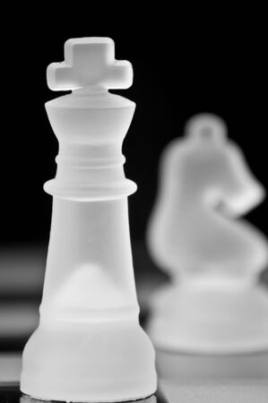 Beautiful chess pieces on black background with stunning color and definition Stock Photo - 8130837