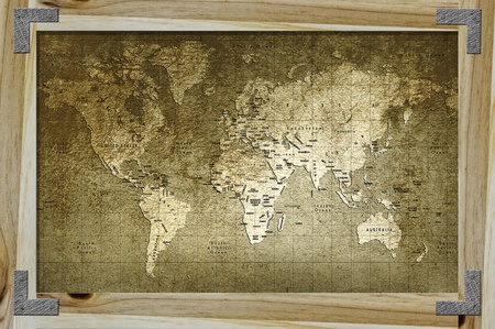 Old world map with great texture and amazing colors in wood frame photo