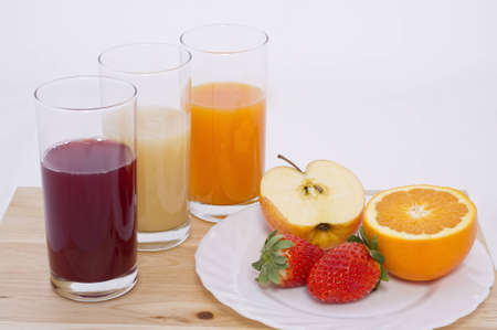 diferent: Some glass with juice of diferent fruit in white background