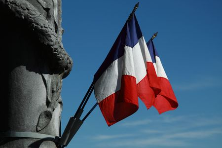 The French tricolour attached to a war memorial in SW France photo
