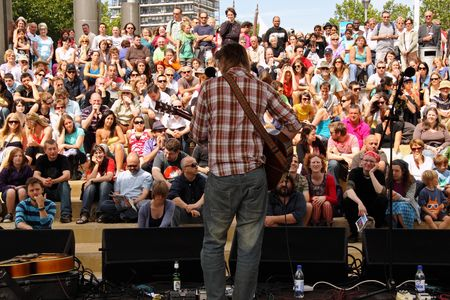 Bristol, England - August 2, 2009 - Guitarist out front on the Cascade Steps stage during the annual Harbour Festival, the largest free event of its kind in Europe, attended by 250,000 people over three days Stock Photo - 6885478